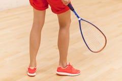 leka squashkvinna Arkivfoto