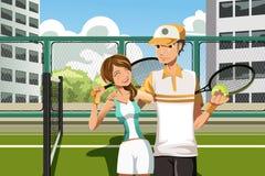 leka tennis för par Arkivfoto