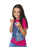 Leka videospel för tonårs- flicka Arkivfoto