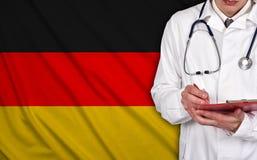 Lekarka i Germany flaga obrazy stock