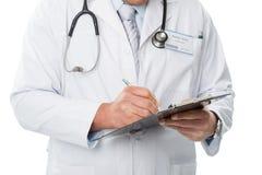 Lekarka w białym żakiecie, pisze falcówka, szczegół fotografia obraz stock