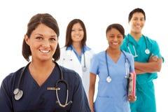 Lekarki: Samiec, kobiet pielęgniarki i lekarki i zdjęcie royalty free