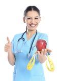 Lekarz medycyny pokazuje jabłka obrazy stock