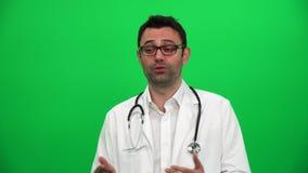 Lekarza Medycyny mężczyzna Opowiada wywiadu pojęcia prezentaci Greenscreen tło zbiory wideo