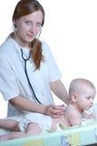lekarze kobieta badania dziecka Fotografia Stock