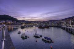 Lekeitio-Docks bei Sonnenuntergang Lizenzfreie Stockfotos