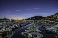Lekeitio docks at sunset Royalty Free Stock Photography