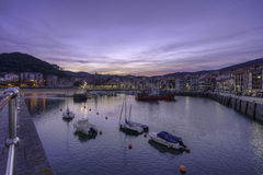 Lekeitio docks at sunset Royalty Free Stock Photos
