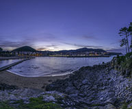 Lekeitio from the Island. Little spanish village of Lekeitio from the little island located right in front. Sunset light gives us beautiful tones Royalty Free Stock Photos