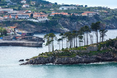 Lekeitio town coastline, Biscay, Spain. Summer Lekeitio town coastline and San Nicolas island (isla de San Nicolas), Biscay, Spain,  Basque Country Royalty Free Stock Photography