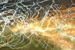 Lekka neonowa abstrakcjonistyczna obraz fotografia a - czarodziejscy światła w zawijasie i fala wzorze, pluskocze i pętle, paskow Fotografia Stock