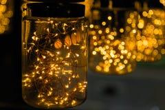 Lekki lampowy wystrój w święto bożęgo narodzenia na bokeh tle Zdjęcia Stock