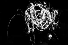 Lekki obraz z sparklers - squiggles w monochromu obrazy stock
