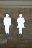 Lekki przewdonik w WS - kształtuje mężczyzna i kobiet jarzy się biały neonowego na ścianie, Obraz Stock