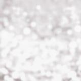 Lekki srebny abstrakcjonistyczny Bożenarodzeniowy tło z rozjarzoną magią bo Obrazy Stock