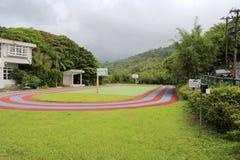 Lekplats av den yangming nationella grundskola för barn mellan 5 och 11 år för berg i taipei Arkivfoto