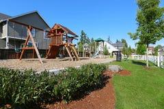 Lekplats i amerikansk grannskap Arkivfoto