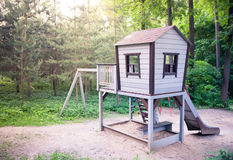 Lekplats i skog med inställningssolen Fotografering för Bildbyråer