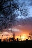 Lekplats under en solnedgång Royaltyfri Bild