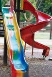 Lekplatsglidbana och barns område Royaltyfria Bilder