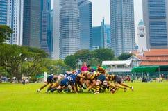 Lekrugbylag i stadens centrum Singapore Royaltyfri Foto