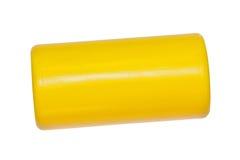 Leksak färgrik gul plast- cylinder arkivbild
