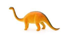 Leksak för brachiosaurus för sidosikt orange på vit bakgrund Fotografering för Bildbyråer