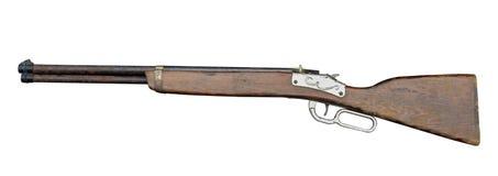 Leksak för vapen för sidosikt gammal på vit bakgrund fotografering för bildbyråer