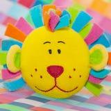 Leksak för lejonframsidabad Arkivbild