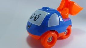 Leksakbärgningsbilen, med muddrar på baksidan arkivfoto
