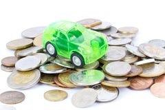 Leksakbil på mynt royaltyfria bilder