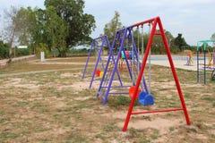 Leksaker på lekplatsen Arkivfoto