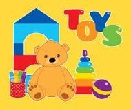 Leksaker på gult horisontal Royaltyfri Foto
