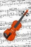 Leksakfiol och musikark Royaltyfria Foton