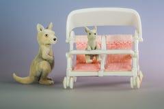 Leksakkängurur med behandla som ett barn stol Royaltyfria Bilder