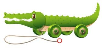 Leksakkrokodil med hjul stock illustrationer