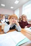 Lektion. Hübscher Schüler in den Träumen Stockfotos