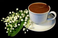 Lelietje-van-dalen en koffie Stock Fotografie