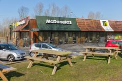 Car park near Dutch motorway with Mc Donald`s fastfood restaurant Stock Photography