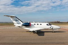 Dutch Lelystad Airport with private Cessna Citation Mustang at runway Royalty Free Stock Photos