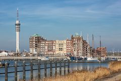 Dutch Harbor of Lelystad with communication Tower and apartment building. Lelystad, The Netherlands - February 23, 2019: Harbor with communication Tower and royalty free stock image