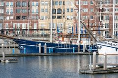 Dutch Harbor of Lelystad with sailing yachts and apartment building. Lelystad, The Netherlands - February 23, 2019: Harbor with sailing yachts and modern royalty free stock photography