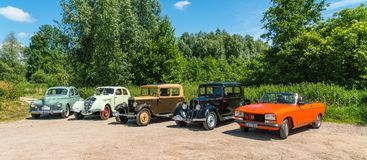 Five Peugeot Oldtimers at the annual  national oldtimer day in Lelystad. Lelystad, The Netherlands, June 18, 2017: Five Peugeot Oldtimers at the annual  national Stock Photos