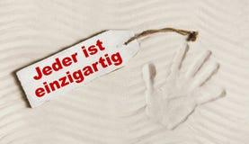 Lema alemán: Todos es único Concepto para el th psicológico imagen de archivo libre de regalías