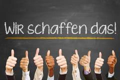Lema de la motivación en alemán en una pizarra imagen de archivo