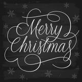 Lema de los saludos de la Feliz Navidad en la pizarra Fotografía de archivo