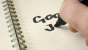 Lema popular escrito en un cuaderno almacen de metraje de vídeo