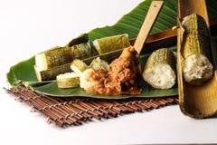 Lemang. Malay lemang served with rendang ayam Stock Images