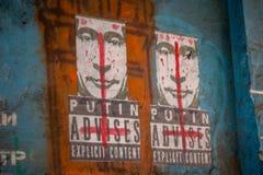 LEMBERG, UKRAINE - 22. Februar 2015: Putin rät ausdrücklichen zufriedenen Graffiti Stockbilder