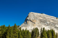 Lembert Dome. Is a granite dome rock formation in Yosemite National Park in the US state of California. The dome soars 800 feet 240 m above Tuolumne Meadows and royalty free stock photo